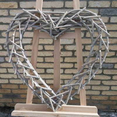 Location coeur en bois grise